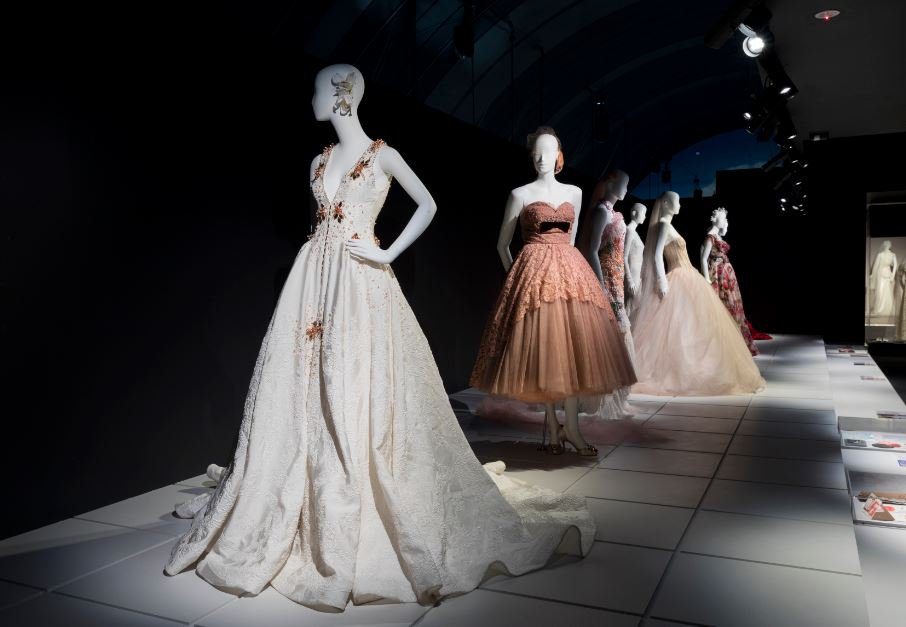 Photo of mannequins wearing wedding dresses made with lace