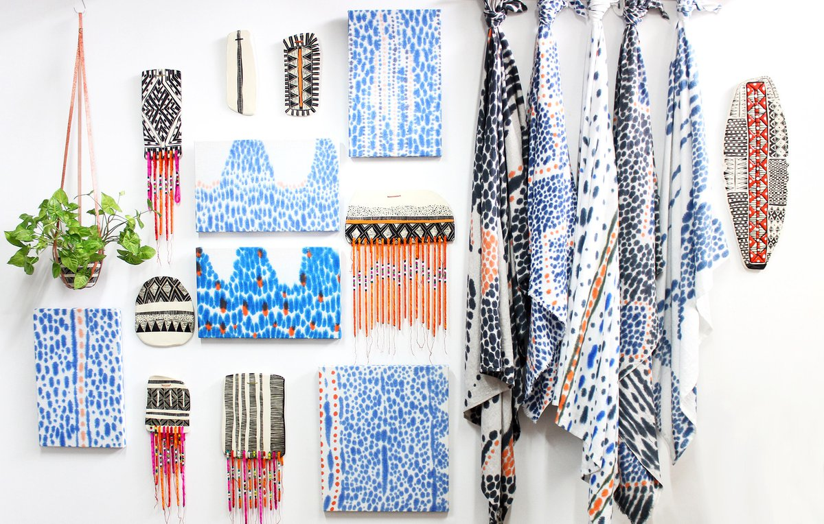 Image: TRADE the MARK - Ceramic wall pieces, hand painted textiles, stretched textiles and hanging ceramic vessel in leather hanger. Courtesy Trade the Mark.